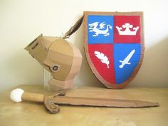 DIY Cardboard Knight helmet, shield and sword.:: the kids would love and promptly destroy this set. Cardboard Sword, Cardboard Costume, Cardboard Crafts, Costume Chevalier, Diy For Kids, Crafts For Kids, Medieval Crafts, Knight Costume, Knight Party