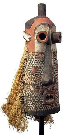 Africa | Pende Pumbu chief's mask | Of the three masks belonging to the chiefly regalia of the Eastern Pende people, Pumbu is deemed the most dangerous and is reserved for only the most powerful chiefs. The Pumbu, unlike the majority of other masks, is only danced on special occasions such as when the chief is seriously ill, in times of illness or famine, when other issues are causing disruption in the community or when the chief feels threatened.