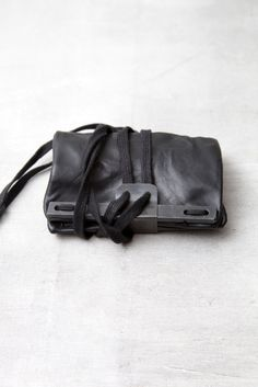 BORIS BIDJAN SABERI, LEATHER WALLET.