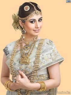 With an attire of traditional zari, kundan or zardozi work, this look dazzles with an airbrushed foundation. The eyes are kept bright and scintillating with earthy and a hint of shimmer, while the lips are highlighted in tones of coffee or peach. The hair is swept up and adorned with accessories, making the bride a stunner on that special day