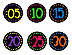 Circular shaped clock number labels with neon colors on black....
