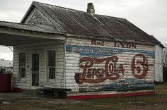 An abandoned old country store pepsi-cola print