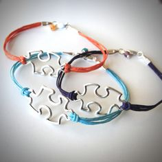 I love these puzzle piece bracelets, but she is way over-charging.  I'm going to figure out how to make them.