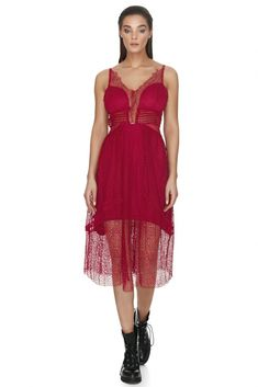 You will be perfectly attired in this sexy transparent lace burgundy dress. The beautiful burgundy color matches the slim fitting bodice, which hugs your curves to make the most of your body. A fanciful lace flourishes over for a sensual look to this short sleeveless lace dress from Vero Milano. This sexy transparent lace burgundy dress will give you a classy and feminine air for your next special occasion.