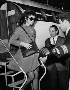 Jackie Kennedy Onassis stepping off a charter in London, 1968.