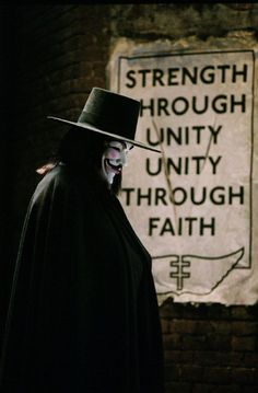 """V for Vendetta,"" 2006 Costume design: Sammy Sheldon black wool felt hat with grosgrain ribbon band and long black wool cape - worn by Hugo Weaving in the role of V V For Vendetta 2005, V Pour Vendetta, V For Vendetta Poster, V For Vendetta Quotes, Vendetta Mask, Pulp Fiction, Science Fiction, Film V, Film Serie"