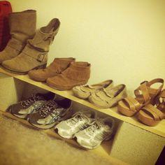 Shoes rack on cinder block shelve.                                                                                                                                                     More