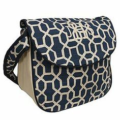 Personalized diaper bag from Hoohobbers in the pebbles navy design in an intriguing, interlocking, pebble-like field of blue.
