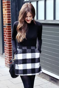 black and white buffalo plaid skirt + black turtleneck + black tights