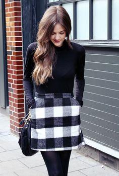 black and white buffalo plaid skirt + black turtleneck + black tights