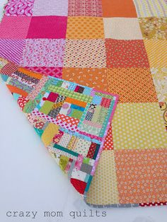 crazy mom quilts | quilting blog {I love that this is reversible, using up smaller squares from stash instead of having to buy large yardage for a backing!}