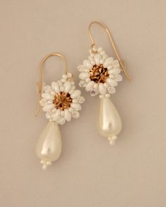 Beautiful Bridal Beaded Earrings made with super duo, pearls, swarovski and seed beads. Earrings length: 4.8 cm- 1.8Inches Gold Filled Earring Ear Wire Hook silicon earring back are attached. for more bridel earrings: https://www.etsy.com/il-en/shop/Ranitit?ref=hdr&section_id=15863972 Your order will be packed in a pretty gift box, as shown in last image. Want to see more items from this shop? click http://www.etsy.com/shop/ranitit