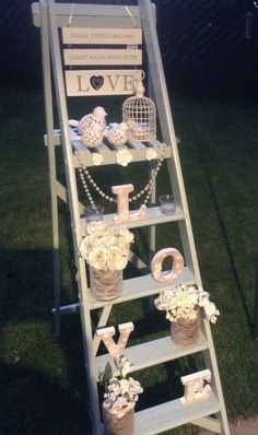 Wedding ladder Statement piece Available to hire .based in Cambridgeshire https://www.facebook.com/pages/TLC-Candy-Cart-Hire/1567572446801237 Please look at our many other beautiful pieces .....look on our Pinterest board or visit our website or fb pages
