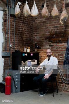 Foto de stock : Butcher in office with hams