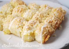Lemon Pull-Aparts ~ These lemon rolls start with frozen dough, so they are super simple to make. But don't tell anyone, and they will never know. They look and taste like you slaved in a hot kitchen for hours. The lemon zest is what gives them amazing flavor, so don't leave it out. They look just as good as they taste!