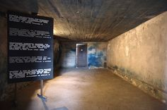 Lublin, Poland - Majdanek concentration camp - Original gas chamber with visible Zyklon B poison gas blue stain on the back wall, permanently burned into the cement.