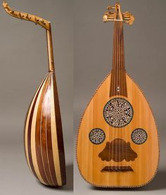 "My first oud - an inexpensive ""wall hanger"" - student quality Egyptian oud, but unusual shallow bowl – often sold as a woman's oud. This type of oud is often very decorative, but not necessarily of good quality, hence the ""wall hanger"" designation!"