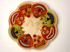 "PATTERN - Primitive Folk Art Wool Applique Candle Mat - ""Halloween Jacks"" (Pattern No. HJ-128). $9.99, via Etsy."