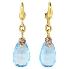 18k gold drop earrings by Pomellato, designed for Pin Up collection, featuring blue topaz teardrops, set with diamonds and sapphires DESIGNER: Pomellato MATERIAL: 18K Gold GEMSTONE: Diamond, Sapphire,