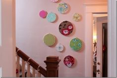 wall art with fabric and embroidery hoops via inspired by charm by abigail