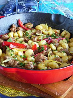 Italian sausage and gnocchi. Healthy it up with chicken sausage and some more veggies (spinach?).