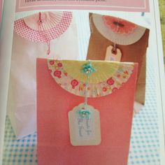 Cup cake wrappers to top off a little brown bag.  Love this idea. :-)