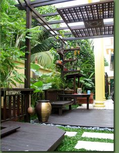 My dream backyard: a tropical oasis that at least reminds me of the beach in some ways. If only I could bring the beach to my backyard...