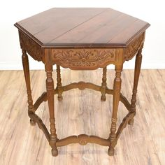 This hexagon end table is featured in a solid wood with a rustic maple finish. This side table is in good condition with spindle legs, carved floral leaf trim and a hexagon table top. Perfect for holding drinks and magazines at the side of a sofa! #europeaninspired #tables #endtable #sandiegovintage #vintagefurniture