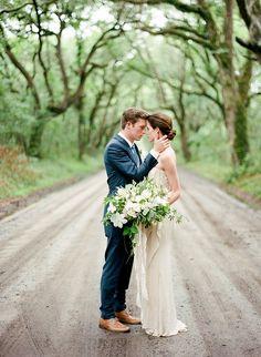 Photographer: Faith Teasley | Ceremony Location: Botany Bay, Edisto Island | Florist:  SYG Designs | Dress: Gossamer Vintage | Men's Suit: Billy Reid