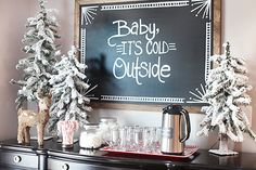 """made the chalkboard using a piece of finish sanded plywood and a few pieces of simple 2″ x 1/4″ trim. Cut the trim pieces to size, stain them with a mixture of Minwax's Special Walnut and Dark Walnut, then """"Liquid Nails"""" them straight to the chalkboard-painted plywood. Easy peasy!   To get the chalk good and dark, dip the chalk in water before using it on the board"""
