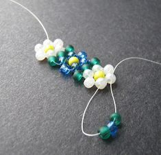 You'll see that once the first flower you stitch is complete, all of the steps will repeat with 2 and 3 beads picked up in each stitch, in the following pattern:    1 leaf, 1 petal, 1 leaf  1 leaf, 1 petal  2 petal, 1 pollen  2 petals  Repeat