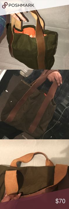Professionally Handmade Tote Bag This bag was handmade by me. It is made up of Soft Khaki Green Twill, 100% genuine raw leather straps, and cotton orange lining with a bleached effect. There is also two functioning pockets. Bags Totes