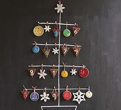 Get the kids in the kitchen to help bake the biscuits for an edible Advent calendar. We've shaped ours to make bunting, snowflake and baubles