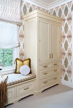 traditional window seat flanked by closet by Sroka Design, Inc.