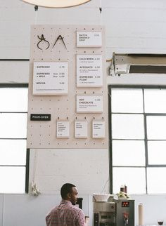 basic pinboard and hanging singage.  restaurant menu signage