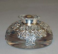 Elegant sterling silver repousse and reticulated cut crystal inkwell attributed to the maker William Comyns, London, 1898