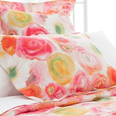 "Rest on a bed of beautiful blooms with this cotton sham. Inspired by a Parisian watercolor and crafted of crisp cotton, this sham evokes a summer sunset in shades of pink, orange, yellow, and green. Create the perfect pairing with other colorful cotton bedding coordinates, like our Embroidered Hem sheets, Boyfriend matelasse coverlets, Marina quilts, and Laundered Linen decorative pillows and throws.   • 100% cotton.  • Knife edge.  • Extended 2 ½"" flange.  • Envelope back closure."