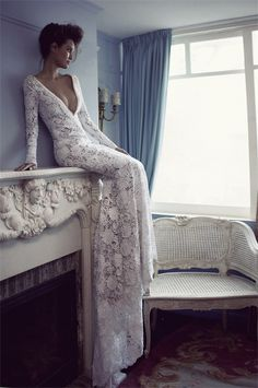 winter wedding long sleeved lace gown. I've always wanted a sexy wedding dress. Something like the low front v-cut would drive him crazy