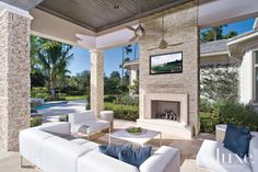 Contemporary Outdoor Neutral Stacked Stone Fireplace