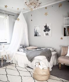Girl's bedroom in pink and grey with fanciful, feminine touches.