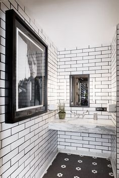 Black and white bathroom with large art. //