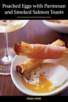 Looking for the ultimate seafood recipe to eat as breakfast or brunch? Look no further. This poached egg recipe incorporates parmesan cheese to melt and form a cheesy, salty crust on the toast, and smoked salmon to add a protein packed seafood to the ultimate brunch recipe. This breakfast salmon recipe calls for sourdough bread, which pairs nicely with the parmesan cheese and the fish.#salmonrecipes #smokedsalmon #brunchrecipes #breakfastrecipes #poachedeggs #eggrecipes Egg Recipes, Salmon Recipes, Brunch Recipes, Wine Recipes, Seafood Recipes, Breakfast Recipes, Protein Pack, Sourdough Bread, Poached Eggs
