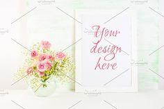 White frame mockup Graphics White frame mockup with blooming Roses. Empty frame mock up for presentation artwork. Template frami by TSTStockMockupPhotos