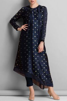 Featuring a navy blue chanderi floral printed assymetrical kurta. It comers along a pair of matching slim pants. Fabric: Chanderi Care Instructions: Dryclean only.