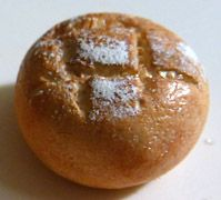 white chalk faux flour on miniature bread or powdered sugar fake food
