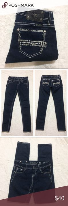 """NWOT Miss Me Easy Skinny Jeans w/ bling Brand: Miss Me  Style: Easy Skinny Condition: New without tags. No bling is missing.  Color: Dark Wash  Size: 24 Front rise: 8"""" Inseam: 31 Fabric Content: 97% cotton 3% elastane   Open to offers Miss Me Jeans Skinny"""