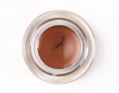 "MAC Rich Ground Fluidline ($15.00 for 0.10 oz.) is described as a ""reddened coco with frost."" It's a subtly red-toned bronzy brown with a soft sheen. Make Up For Ever #14 is darker, redder. Make Up For Ever #12 is more copper in color. Urban Decay Lucky is rather similar, perhaps a smidgen more copper."