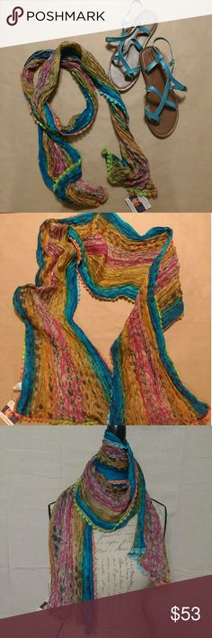 Bright Sundance Silk Scarf from India NWT purchased from Sundance. Vibrant shades of blues and magenta ripple into warm gold's in a hand dyed, individual 100% silk scarf made in India. Designs by Sudha Accessories Scarves & Wraps