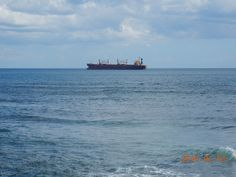 Cargo ship on the Caribbean. We were at Adrian Tropical near the Colonial Zone enjoying some refreshments and the beautiful view. This picture was taken in February 2016.