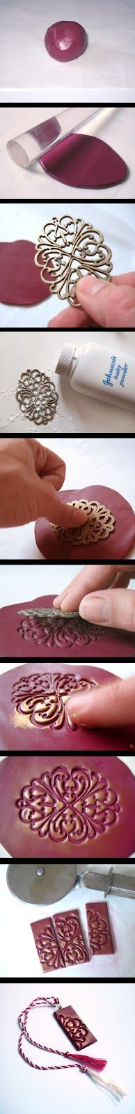 pendant of Polymer clay using brass filigree as a stamp.